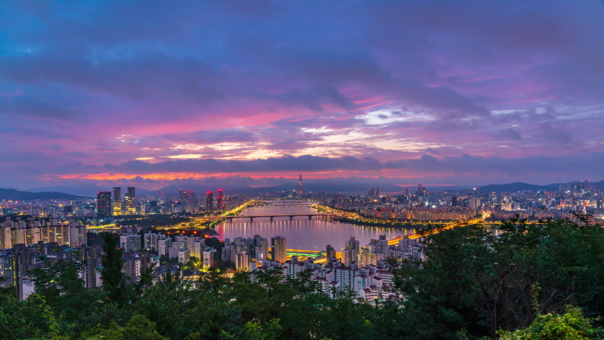 Time lapse 4k Sunrise of Seoul city at han river in South Korea.Zoom in Royalty-Free Stock Footage #1057566184