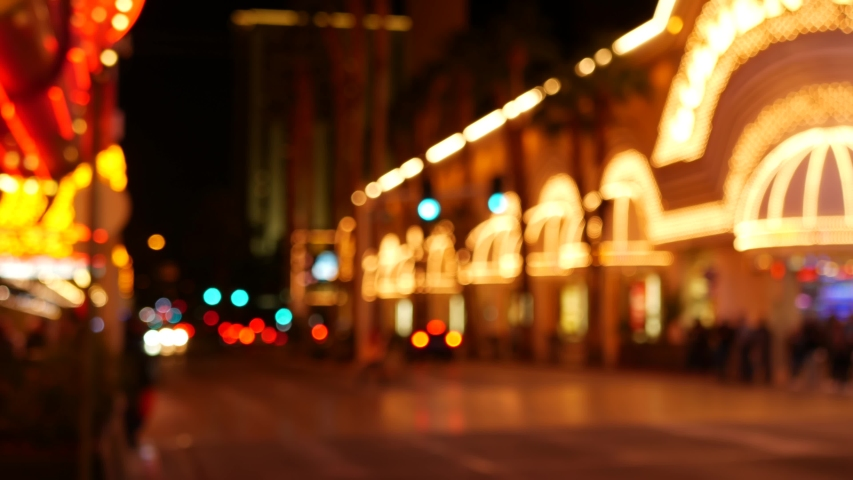 Defocused fabulous Las Vegas Strip boulevard, luxury casino and hotel, gambling area in Nevada, USA. Nightlife and traffic near Fremont street in tourist money playing resort. Neon lights of sin city. | Shutterstock HD Video #1057567078