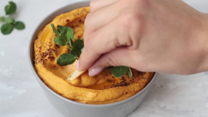 Sweet potato hummus or pumpkin dip in a gray bowl. Royalty-Free Stock Footage #1057577806
