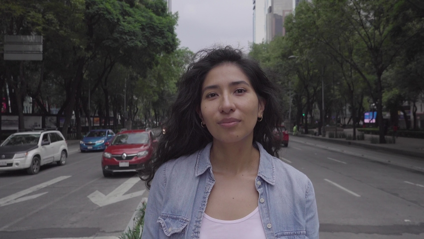 Portrait of a cute young latino woman smiling to the camera 4k