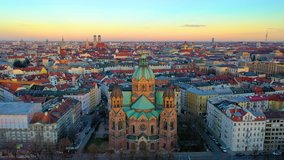Drone video of Munich aerial skyline view from above view of city centre church and marienplatz square from above, sly over church isar river germany.