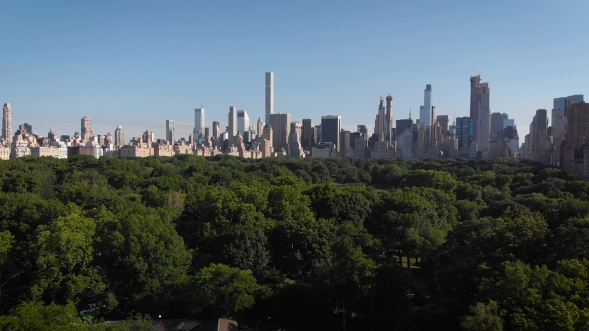 Aerial view of Central Park and Manhattan in New York USA during summer season. Green trees beautiful nature city skyscrapers blue sky