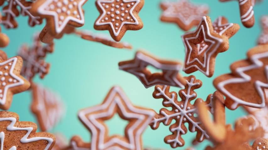 3d Christmas biscuits in the shapes of snowflakes and stars with icing, gingerbread cookies falling and rotating, isolated on blue background. Holiday animation with motion blur | Shutterstock HD Video #1057629031
