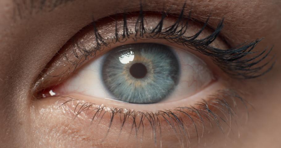 Close up macro eye opening human iris beautiful blue eye healthy eyesight awareness concept