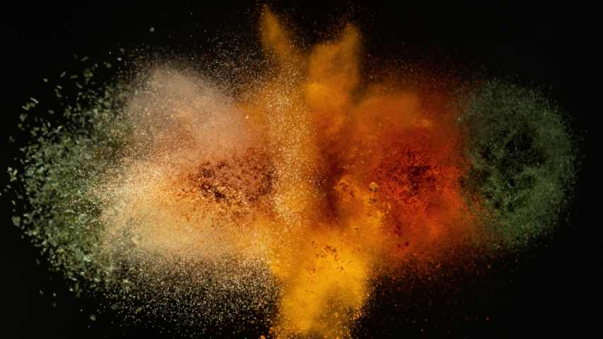 Super Slow Motion Shot of Colorful Seasoning Explosion on Black Background at 1000fps. | Shutterstock HD Video #1057638766