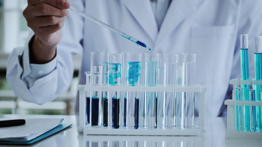 Scientist test for Covid-19 or Corona virus By using science tubes to research and treat illness cancer in lab or hospital. Medical treatment concept Royalty-Free Stock Footage #1057642732