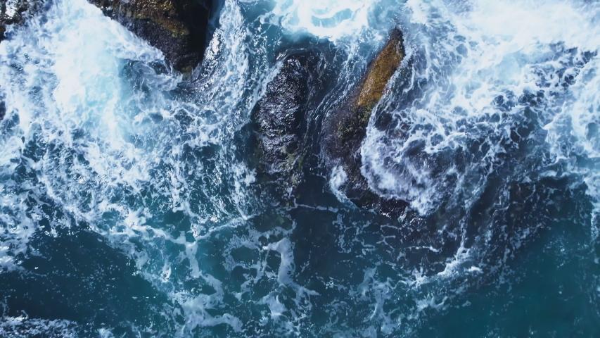 Top view of big sea waves crashing at rocks at the sea coast Royalty-Free Stock Footage #1057654720