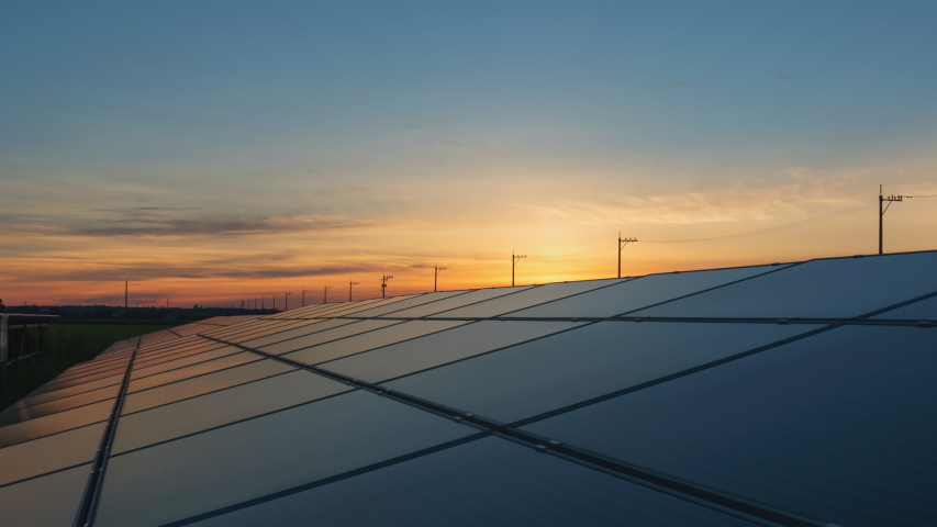 Time-lapse 4K large industrial Solar Energy Farm producing concentrated solar power.Day to night  | Shutterstock HD Video #1057662526