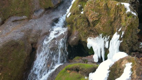 Waterfall Silver stream and mossy rock in winter. Grand Canyon, Crimea, Ukraine