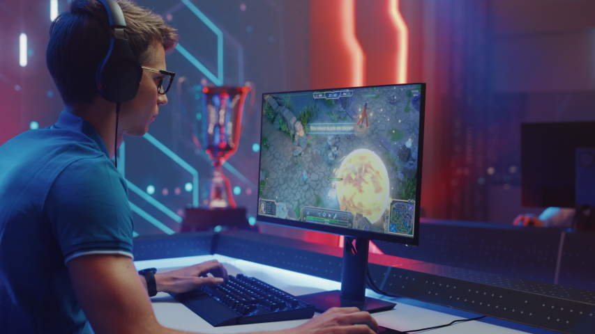 Professional eSports Gamer Plays RPG MOBA Mock-up Video Game with Fun Special Effects on Computer at Championship Event. Online Cyber Tournament. Arc View Medium Shot | Shutterstock HD Video #1057670281
