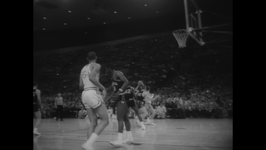 CIRCA 1965 - The UCLA Bruins defeat the Michigan Wolverines in the NCAA basketball playoffs.