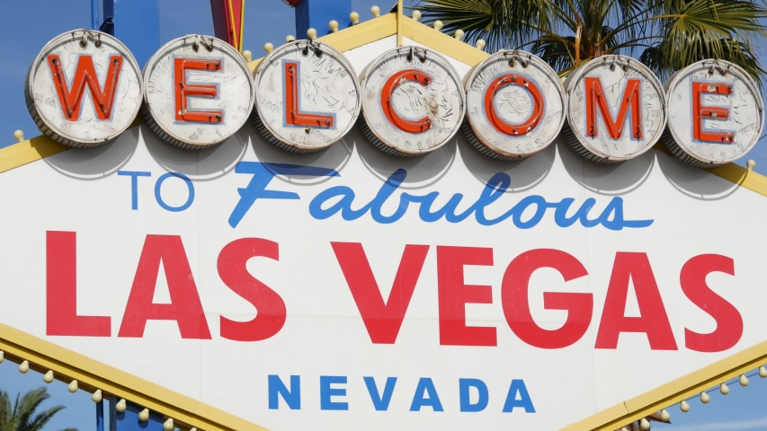 Welcome to fabulous Las Vegas retro neon sign in gambling tourist resort, USA. Iconic vintage banner as symbol of casino, games of chance, money playing and hazard betting. Lettering on signboard. | Shutterstock HD Video #1057675123