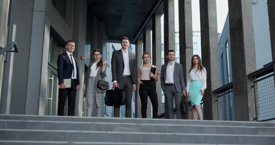 Happy proud professional diverse business people group look at camera. Corporate team portrait. Smiling team of diverse different generations business people looking at camera. Royalty-Free Stock Footage #1057678570