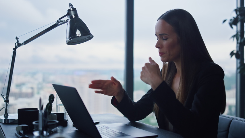 Businesswoman talking with business partner on video chat in office. Confident female manager call video on laptop in home office. Cheerful business woman having online conference on laptop | Shutterstock HD Video #1057689466