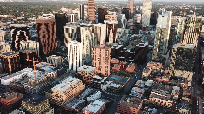 Downtown Denver Colorado Skyline. Drone Aerial View on Business Skyscrapers Under Evening Sunlight