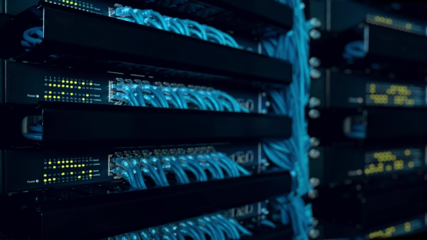 Close up fiber optic in server room. Network cables installed in the rack at data center. Ethernet cable on network switches background Royalty-Free Stock Footage #1057714198