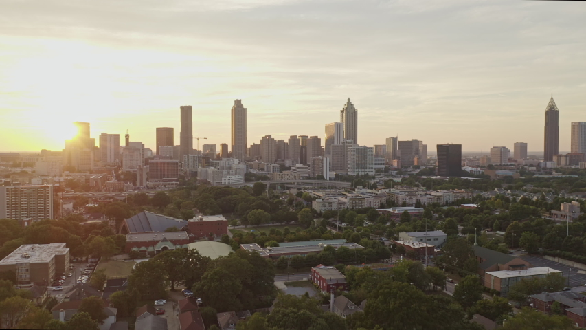 Atlanta Aerial  Extended downtown sunset cityscape flying from Sweet Auburn through downtown skyline and beyond - September 2018