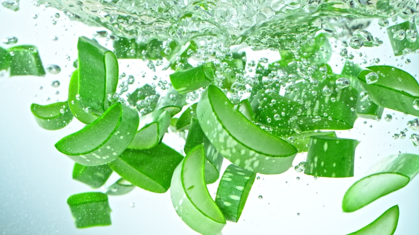 Super Slow Motion Shot of Aloe Vera Cuts Falling into Water on White Background at 1000fps. | Shutterstock HD Video #1057746658