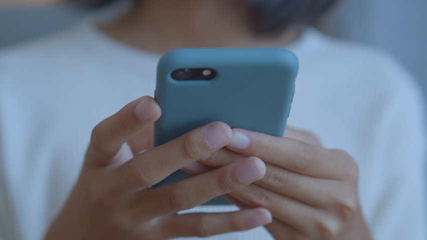 Hand of Asian girl using texting mobile phone or chat. Close up of woman hand Royalty-Free Stock Footage #1057758922