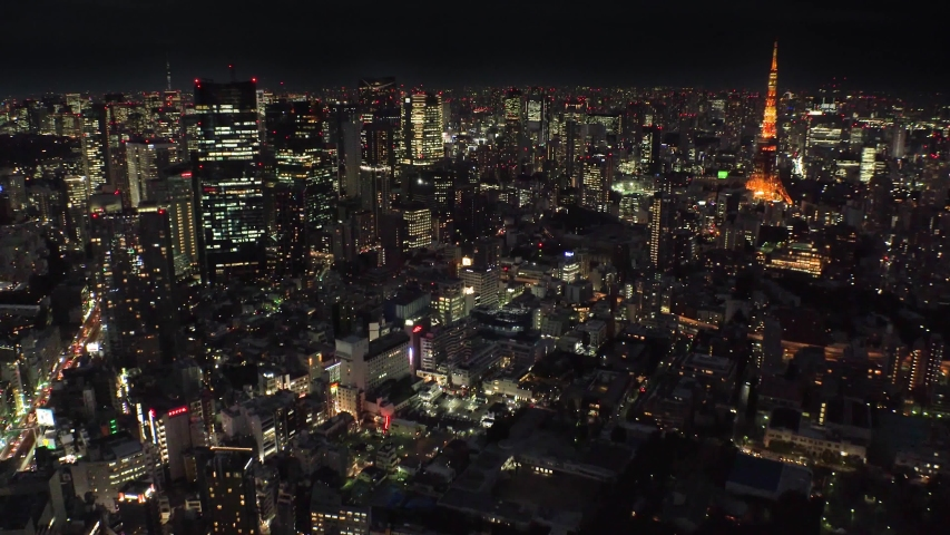 TOKYO, JAPAN : Aerial high angle sunset CITYSCAPE of TOKYO. View of central downtown area around Roppongi. Japanese urban metropolis concept shot. Long time lapse shot sunset to night.
