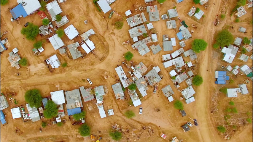 Aerial view of houses on red dirt in Lagos, Nigeria. | Shutterstock HD Video #1057764895