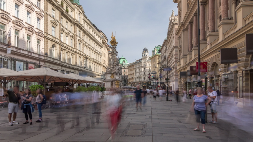 People is walking in Graben St. timelapse hyperlapse, old town main street of Vienna with many shops and restaurants, Austria. The column, called The Pestsaule, was inaugurated in 1693 after the end | Shutterstock HD Video #1057767142