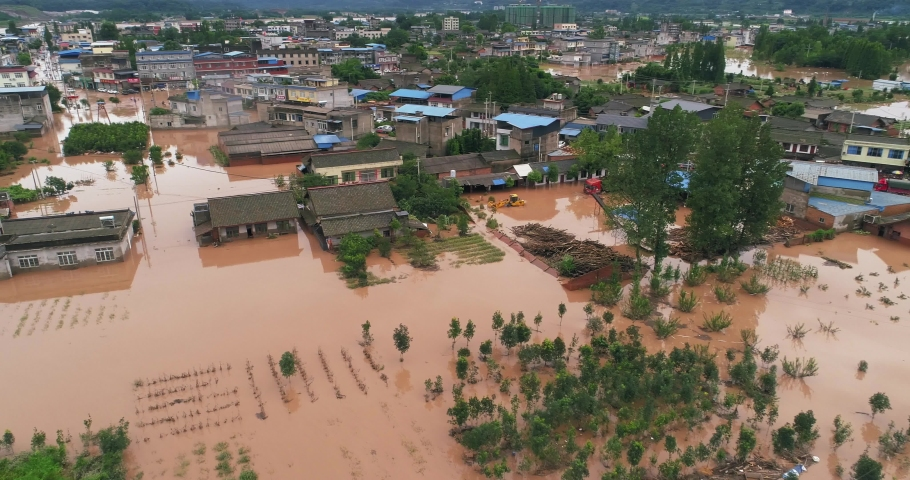 Aerial view of small town been flood Flooded Chinese neighbourhood in Leshan Sichuan China at 2020 Homes, houses overflowing water people walking in the water car driving in flood Royalty-Free Stock Footage #1057767313