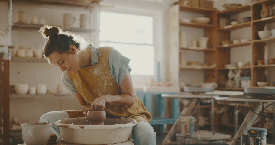 Young woman in pottery studio using pottery wheel, handmade ceramics, creative | Shutterstock HD Video #1057795366