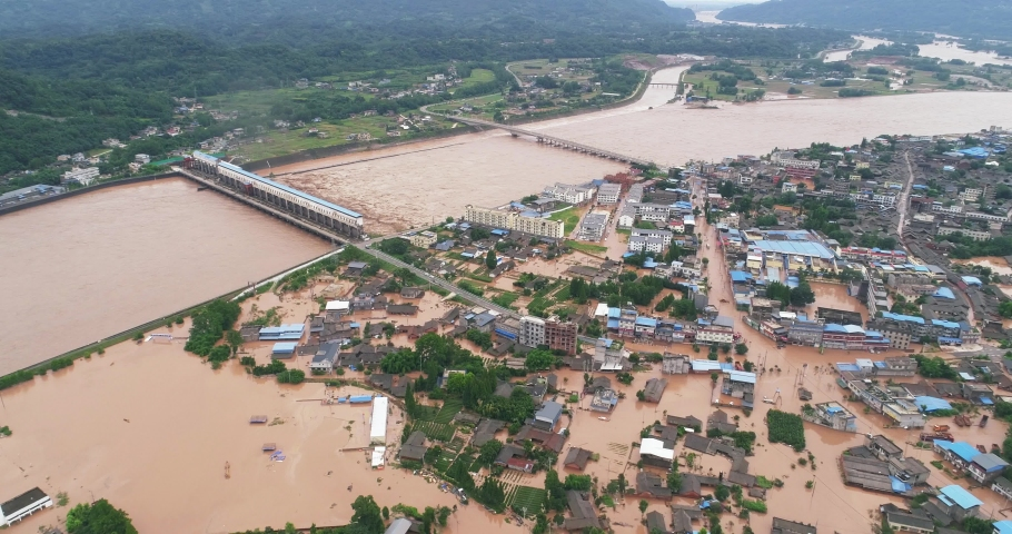 Aerial view of small town been Flooded countryside neighbourhood in Sichuan China at 2020 Homes, houses overflowing muddy water concept of nature disaster climate change 4k footage  | Shutterstock HD Video #1057797673