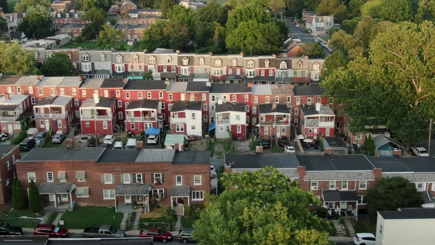 Aerial truck shot of slums in United States, low income, poverty housing, slumlord, crime district, urban America city establishing shot