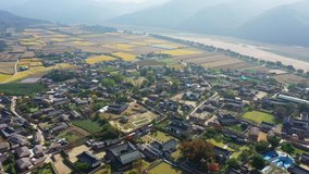 Aerial video of Andong Hahoe Folk Village in Autumn South Korea, A village surrounded by a river.