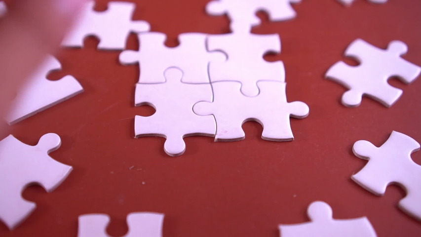 Hand holding jigsaw puzzles,Business group wanting to put pieces of puzzle together.