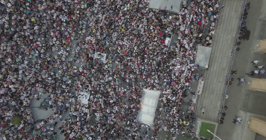 People protesting political views in front of Governmental building. Aerial shot of manifestation