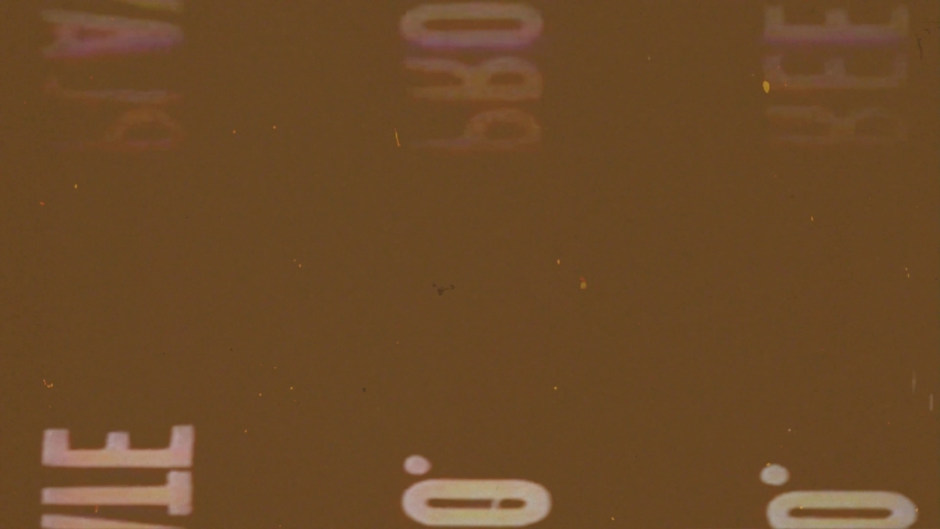 Writing, Old Film Leader with dust and scratches, Vintage Damaged Film Strip, Brown Background