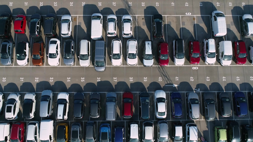 Reveal drone shot. Drone flies over a large used car parking lot. Logistics transit.  Royalty-Free Stock Footage #1057865701