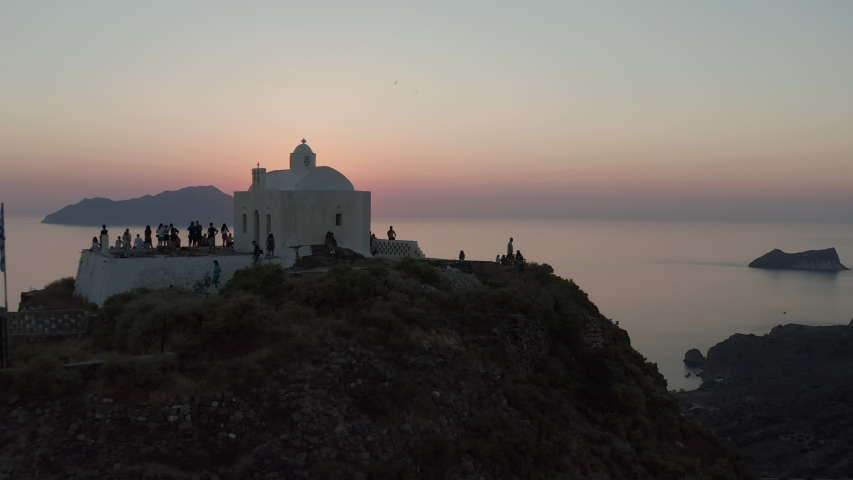 People Tourists Enjoying the Sunset from Church Viewing Point over Island in Greece   Shutterstock HD Video #1057878931