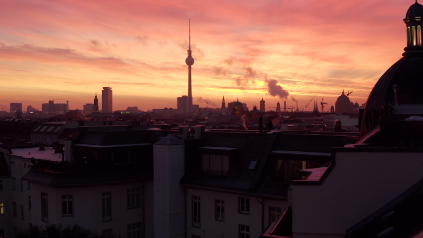 Low flight over Berlin Rooftops with Fire Red Sunrise Sunset
