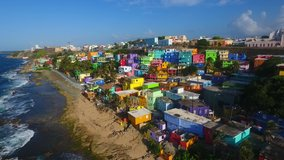 Aerial view of La Perla neighborhood in San Juan Puerto Rico during summer season. Sea waves beautiful beach colorful houses urban dangerous drug crime despacito music video filming location