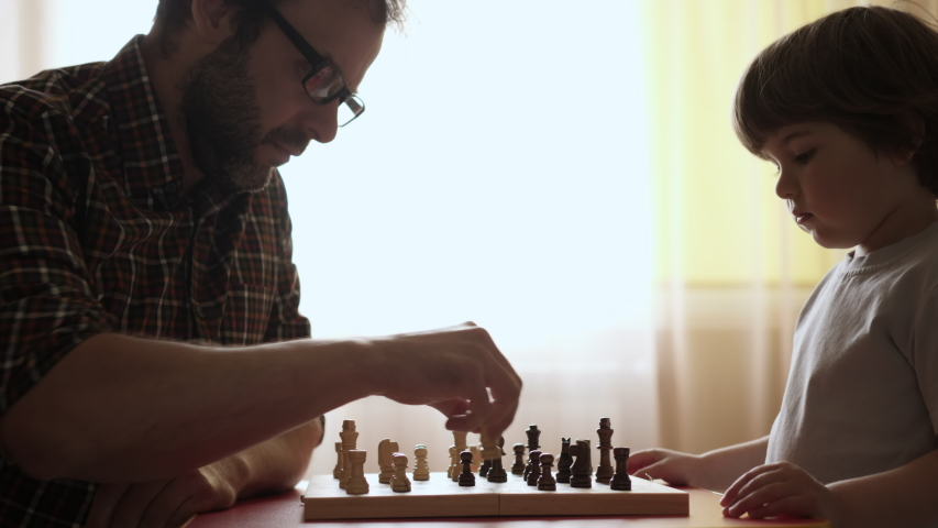 Portrait of Smart Little Boy and Father Playing Chess. Child Playing Chess With Friend at Home, Development of Logical Thinking for Children. Intellect, Intelligence. Development Logical Thinking.  | Shutterstock HD Video #1057890175