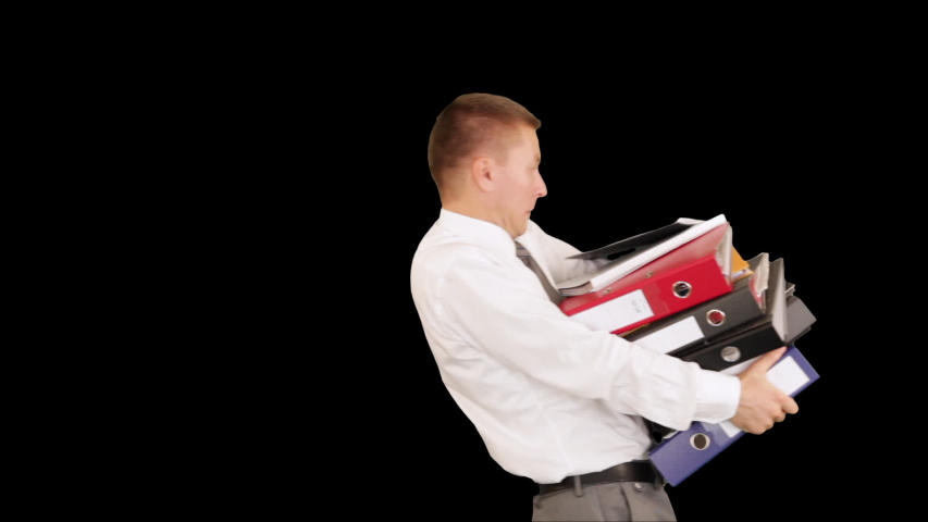 Young businessman carrying files and folders, Luma Mate attached | Shutterstock HD Video #1057892152