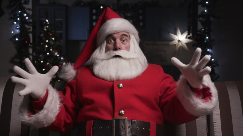 Funny Scared Santa Claus. Portrait Santa Claus Look at Camera Background of Home New Year Decor Interior and Christmas Tree. December Evening Xmas Eve Surprise. Christmas Night Lights. | Shutterstock HD Video #1057925179