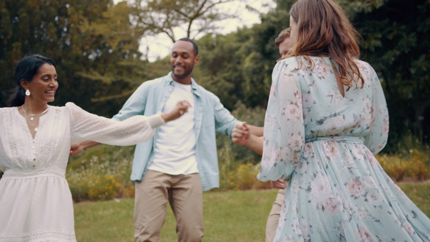 Couples enjoying dancing together outdoors. Multi ethnic group of friends hanging out dancing at park on a summer weekend.