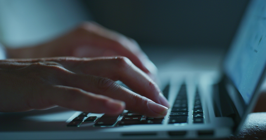 Close up shot of an young business woman's hands busy working on laptop or computer keyboard for send emails and surf on a web browser late hour at night. Royalty-Free Stock Footage #1057929418