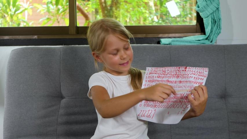 Preschooler child girl teach math, online education. Kid make school homework online. Distance education at home Royalty-Free Stock Footage #1057938943
