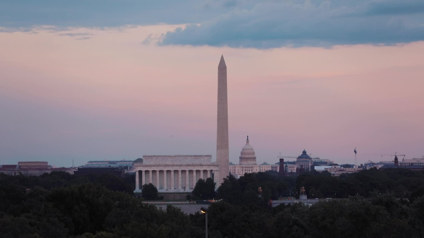A view of the US Capitol building, the Lincoln Memorial and the Washington Monument at sunset in the District of Columbia.