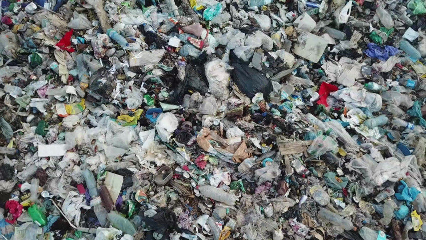Polluted ocean beaches with plastic waste, garbage platform. The concept of environmental pollution and environmental catastrophe. Mountains of garbage, ecological catastrophe for nature Royalty-Free Stock Footage #1057955593