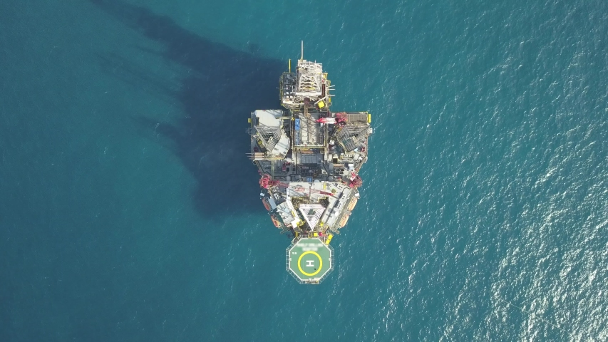 Aerial view from a drone of an offshore Supply Vessel For Oil Drilling Rig in The Middle of Ocean  Royalty-Free Stock Footage #1057962484