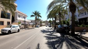 POV driving by the sea in a Spanish seaside town