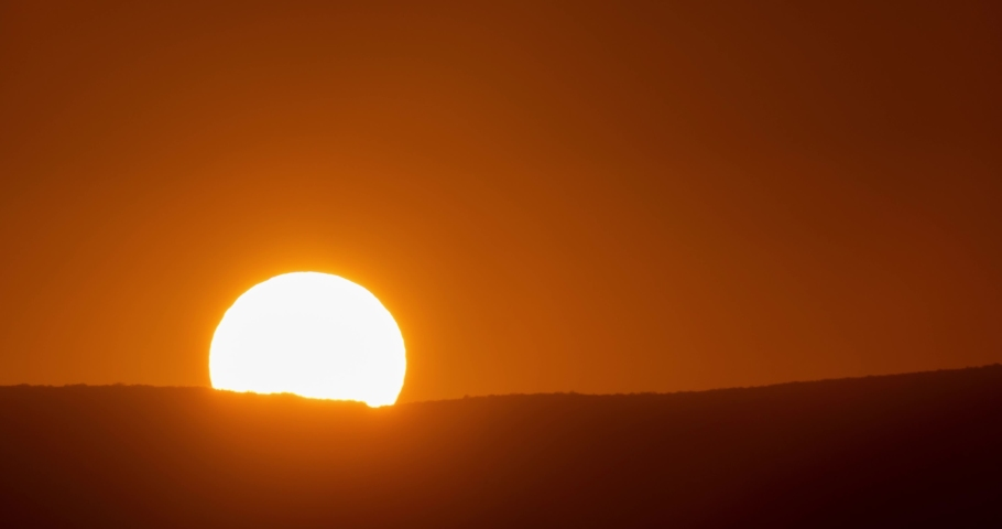 Big sun close-up rising at mountain. Beautiful nature video time lapse landscape.