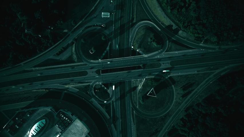 Dark night intersection, aerial hyperlapse. Traffic on highway cloverleaf junction interchange   Shutterstock HD Video #1058008615